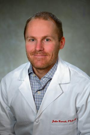 John Barrett in a white labcoat
