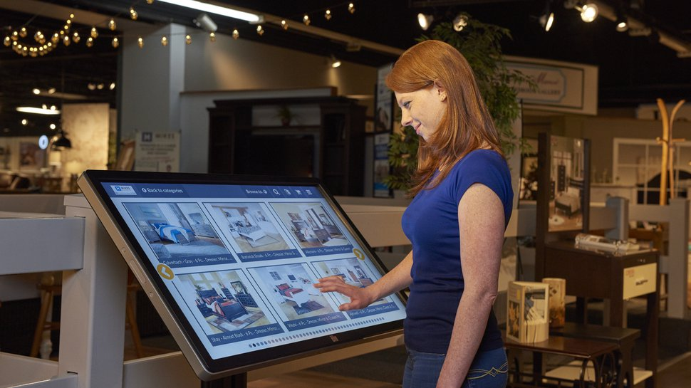 An Elo touchscreen kiosk aids in customer product selection