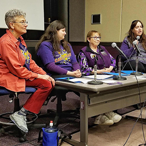 Four homecare workers wearing 'Care Power' t-shirst