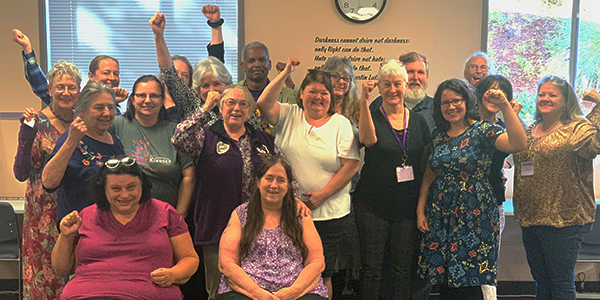 SEIU 503 Homecare Bargaining Team group photo with fists up