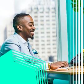 Smiling man typing on keyboard