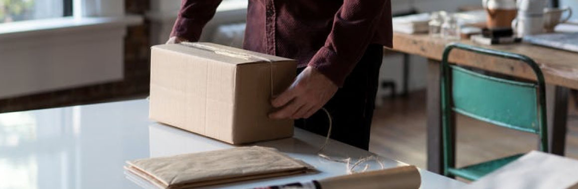 Image of package being prepared for shipment.