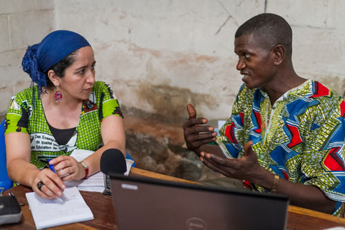 Wycliffe missionary working with a national translator
