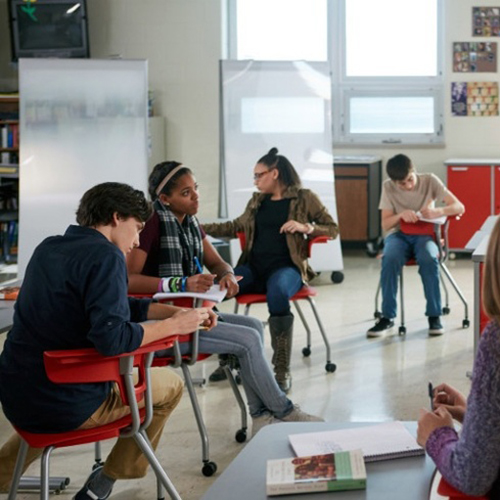 Teens sitting on Ruckus chairs in a classroom