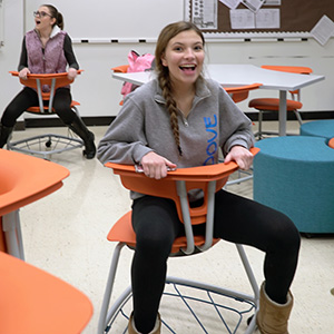 Girl sitting on a Ruckus chair