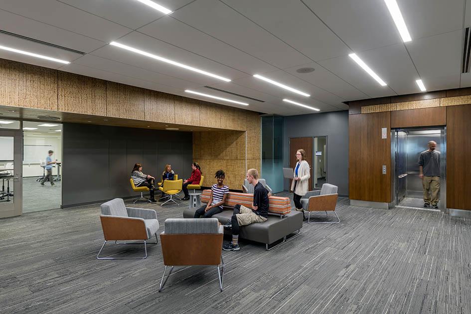 Students talking on lounge furniture