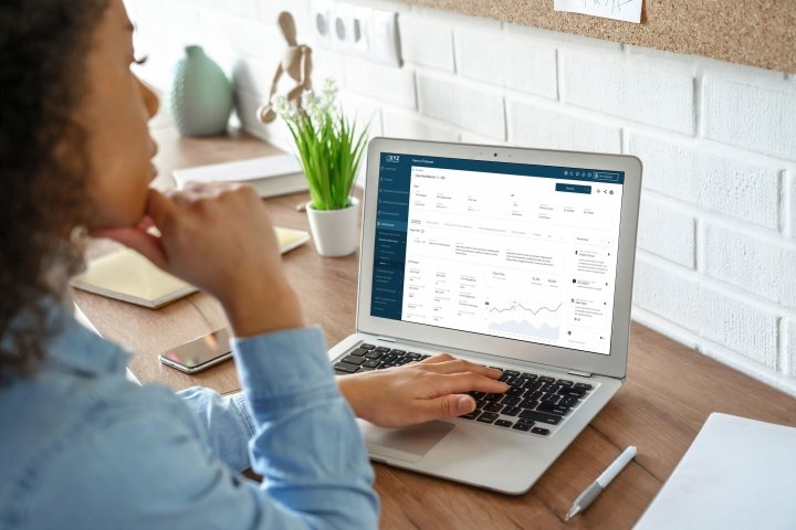 woman looking at compliancealpha on laptop