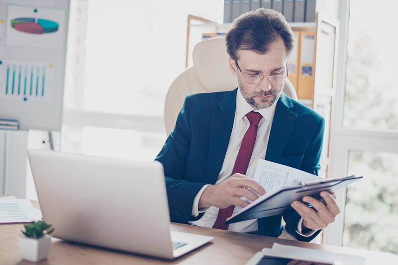 man looking at paperwork