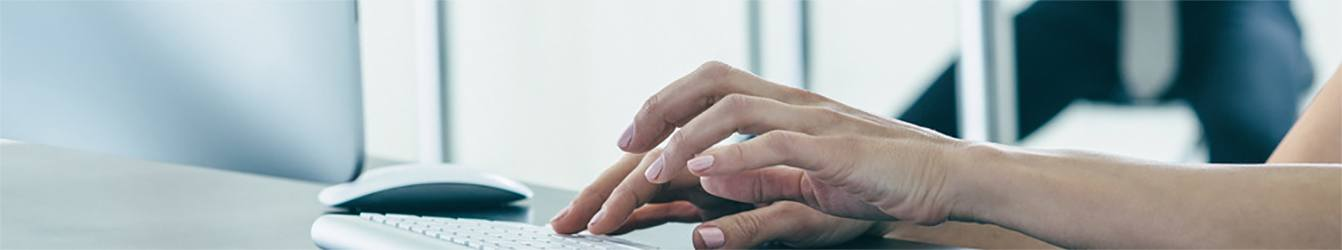 Page banner - Hands on keyboard close up