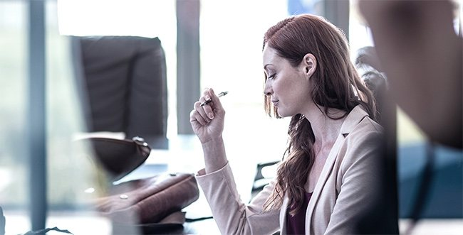 Woman in office sitting at desk