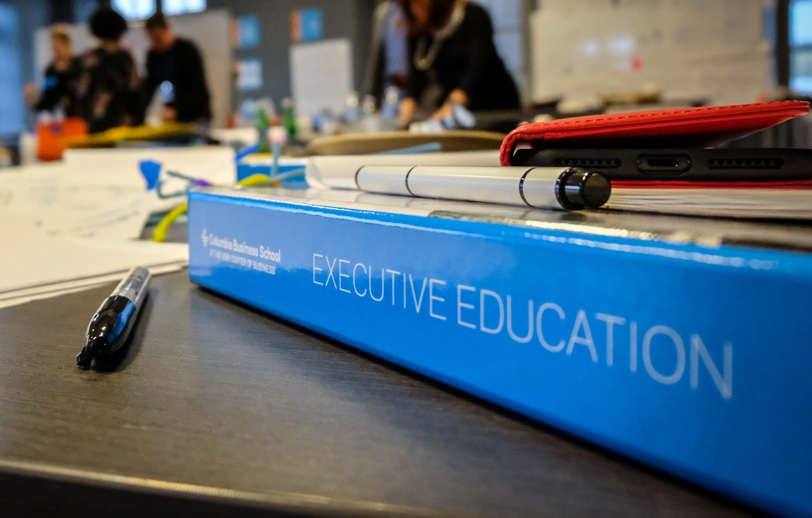 binder with Executive Education written down the spine