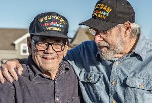 Two veterans talking outside