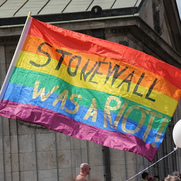 Picture of rainbow flag with the words Stonewall was a Riot