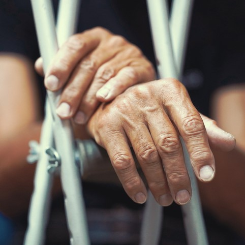 Man's hands on crutches.