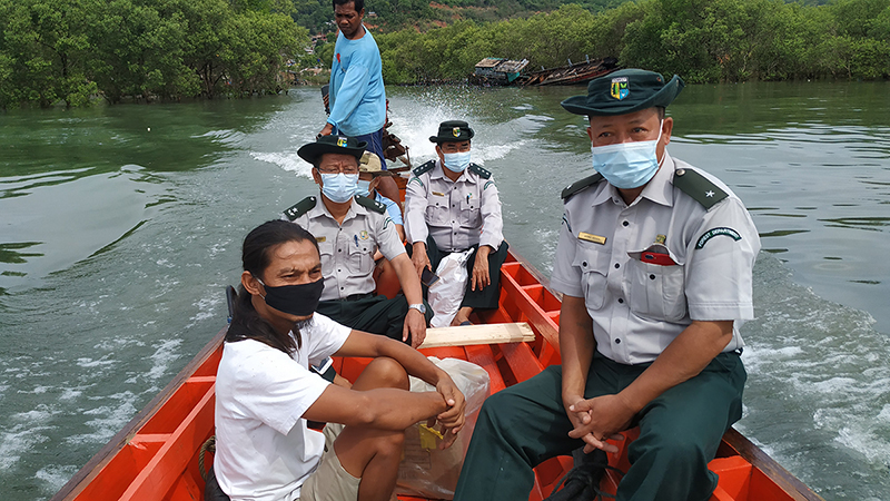 Landesa staff with Myanmar Forest Department officials in a boat.