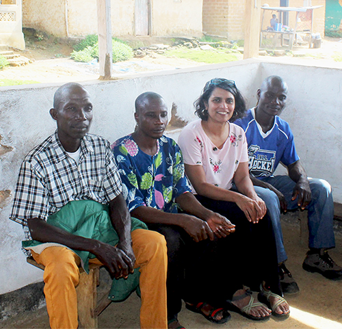 Cedar (second from right) with three leaders whom she interviewed in Liberia.