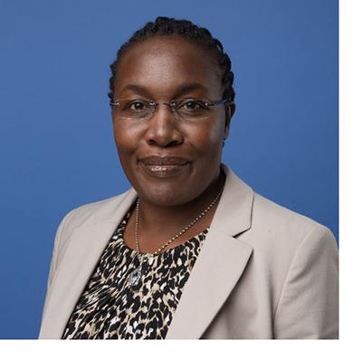 Dr. Margaret Rugadya headshot with blue background