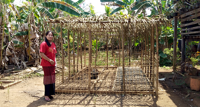 Ma Phyu next to her nursery