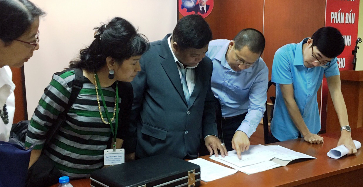 The Myanmar Government Director of land records (center) meets with land registry officials from Vietnam in July to review the process of issuing joint titles for women and men.