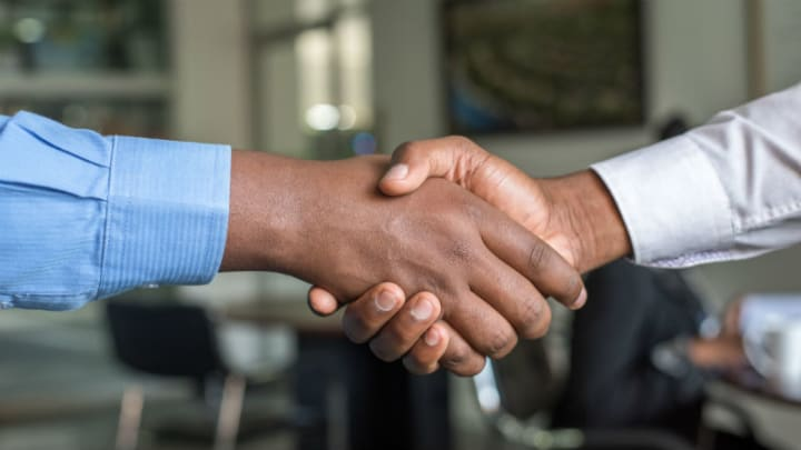 Shaking hands cover image for Op-ed. Photo by Cytonn Photography on Unsplash