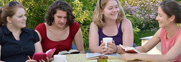 Four young women talking