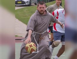 Priest playing basketball