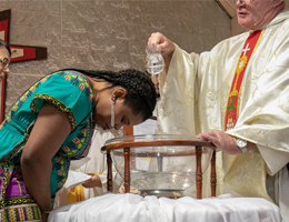 Adult woman being baptised