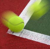 tennis ball hitting baseline corner