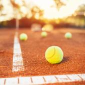 tennis balls inside the baseline