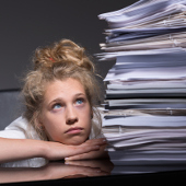 worker frustrated with unruly pile of documents