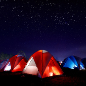 tents on campground with starry sky above