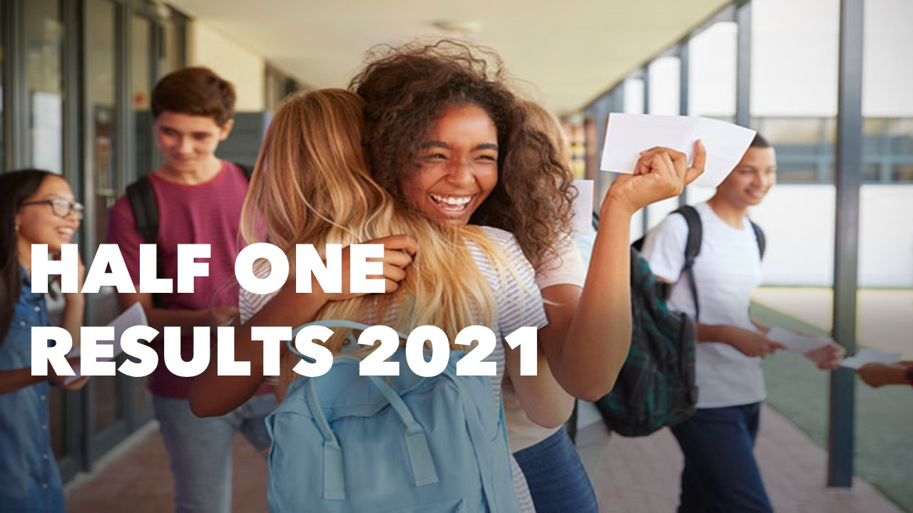 Two people hugging after receiving good results