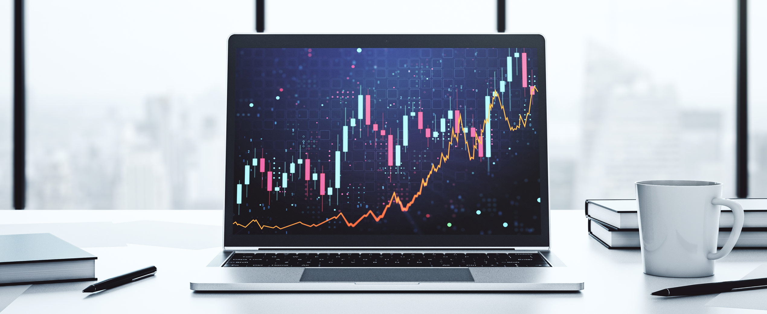 Laptop showing financial charts.