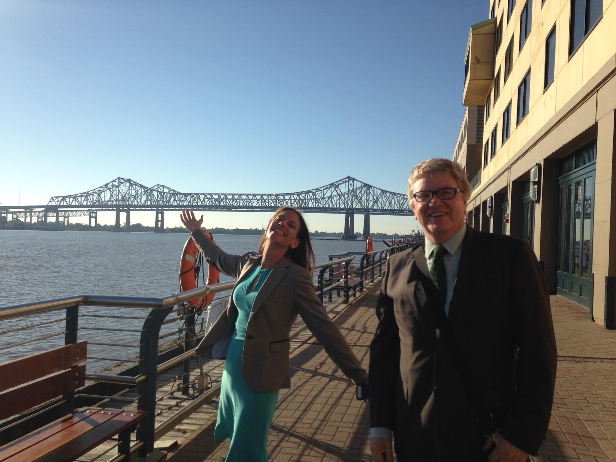 motum b2b leadership walking along the pier in New Orleans.
