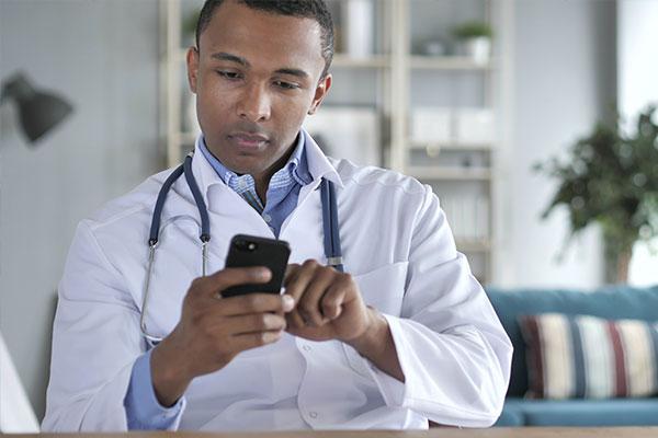 Doctor using smartphone at desk