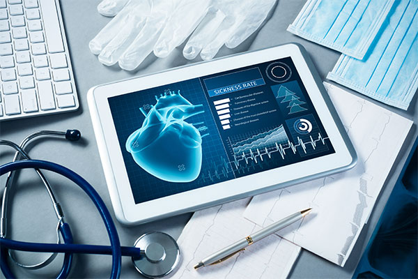 desk with stethoscope and tablet of healthcare ui