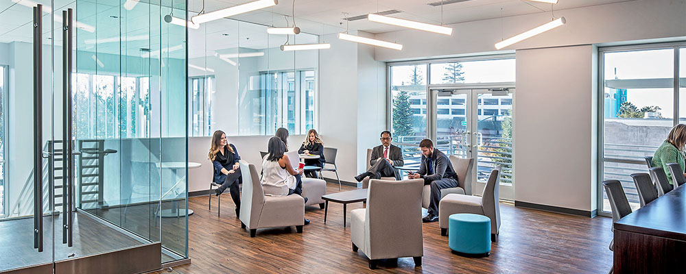 Photo of an open plan office with employees sitting