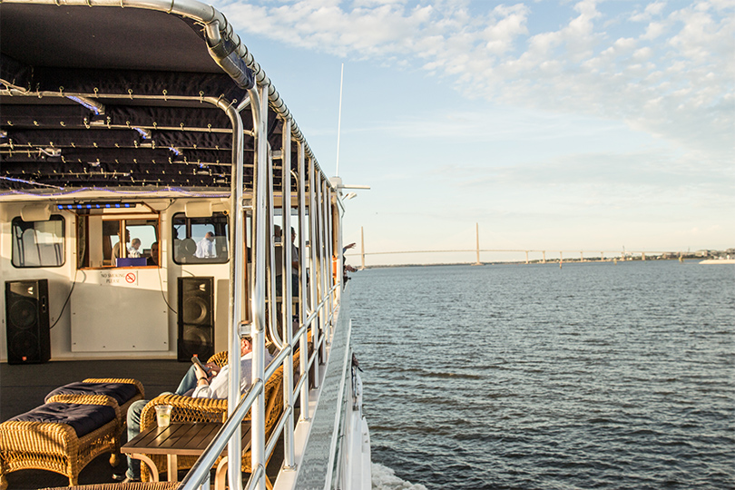 Photo of a boat facing the captain's quarters on Charleston Bay